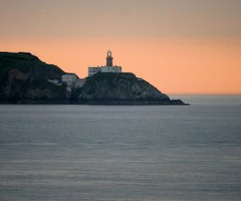 balley lighthouse howth ireland by David Dixon