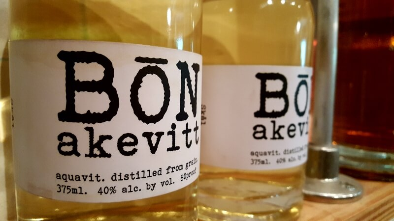 Enjoy Texas spirits and food, like Akevitt or Aquavit from Bone Spirits Distillery in Smithville TX (photo by Sheila Scarborough)