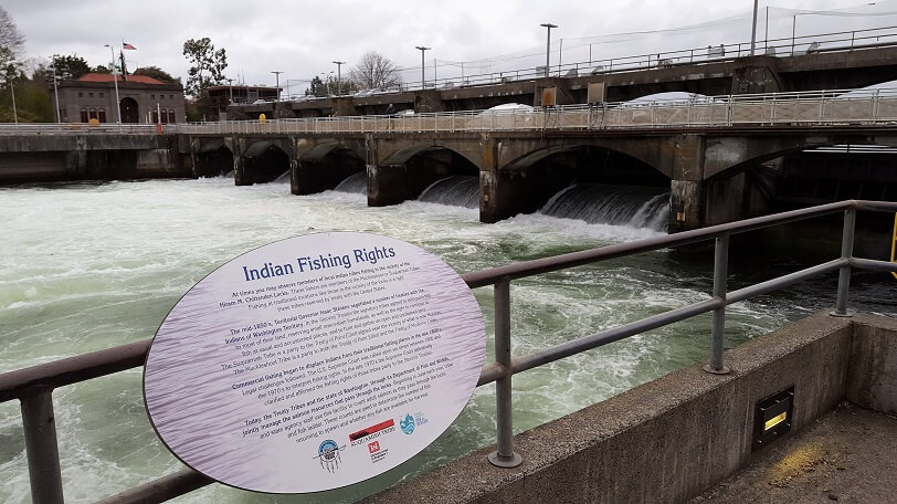 Ballard Locks Seattle waterway plus Indian fishing rights sign (photo by Sheila Scarborough)