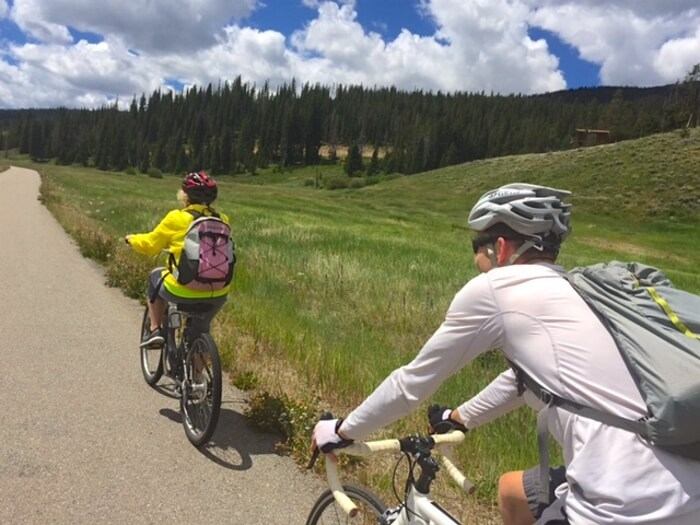 Cyclists on a bike tour in Colorado's Rocky Muntains