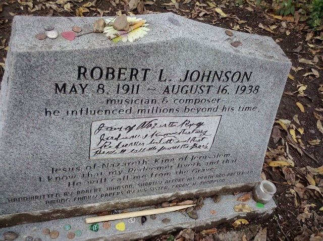 Blues legend Robert Johnson's gravesite near Greenwood, Mississippi. So they say. Maybe. See all of the guitar pick offerings? (photo by Sheila Scarborough)