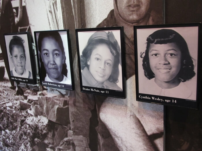 Photos of the victims of the 1963 bomb in Birmingham, Alabama, on display in the Birmingham Civil Rights Institute