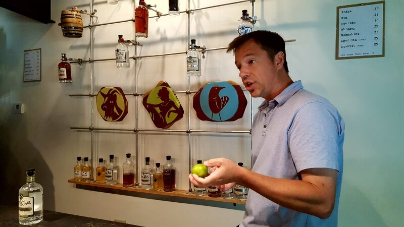 Bone Spirits Distillery founder and owner Jeff Peace in the tasting room in Smithville TX (photo by Sheila Scarborough)