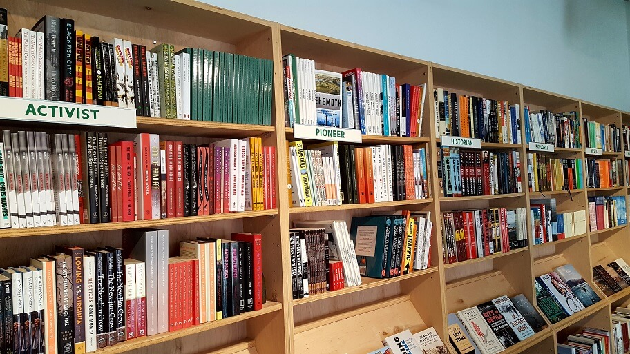 Books sorted by personality and outlook at Commonplace Books and Kitchen Midtown Oklahoma City (photo by Sheila Scarborough)
