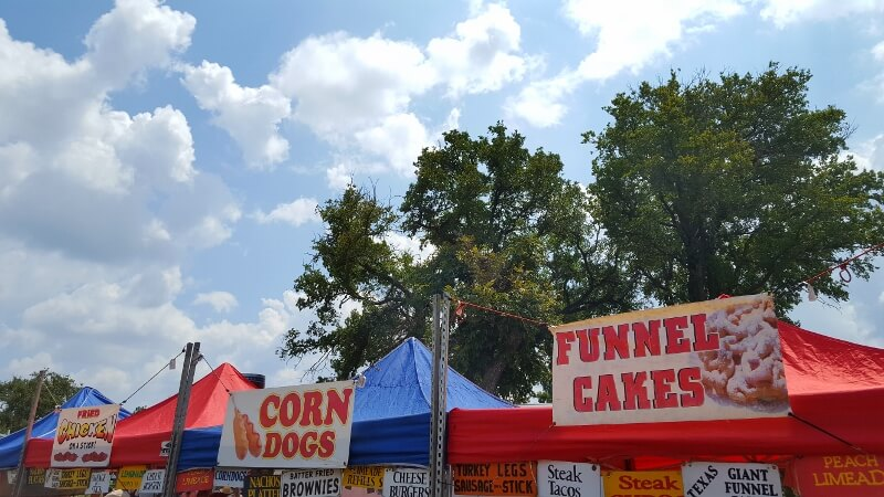 Carnival or fair food trifecta chicken corn dogs funnel cakes at Brady TX Goat BBQ Cookoff (photo by Sheila Scarborough)