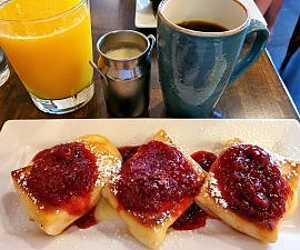 Cheese blintzes with raspberry puree at Skillet near German Village area of Columbus OH (photo by Sheila Scarborough)