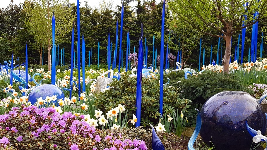 Chihuly Garden Seattle flowers plus blue glass spikes (photo by Sheila Scarborough)