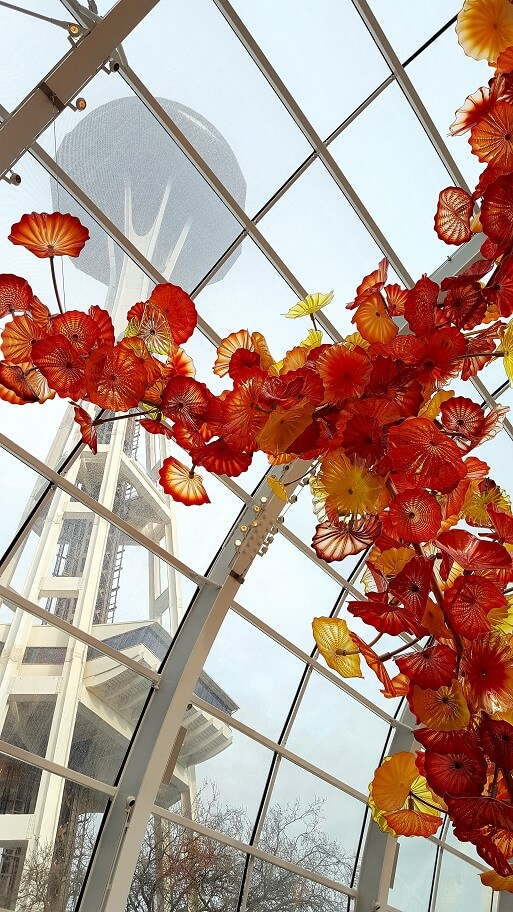 Chihuly Glasshouse with Seattle Space Needle in background (photo by Sheila Scarborough)