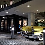 Classic car outside midcentury modern Statler hotel downtown Dallas TX (photo by Sheila Scarborough)