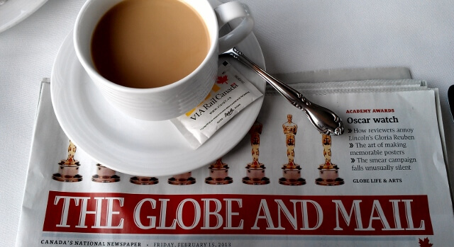 Coffee and the paper on the VIA Rail Canadian train (photo by Sheila Scarborough)