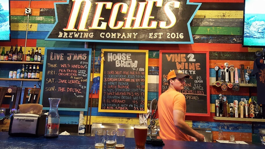 Colorful bar at Neches Brewing Company craft beer downtown Port Neches TX (photo by Sheila Scarborough)