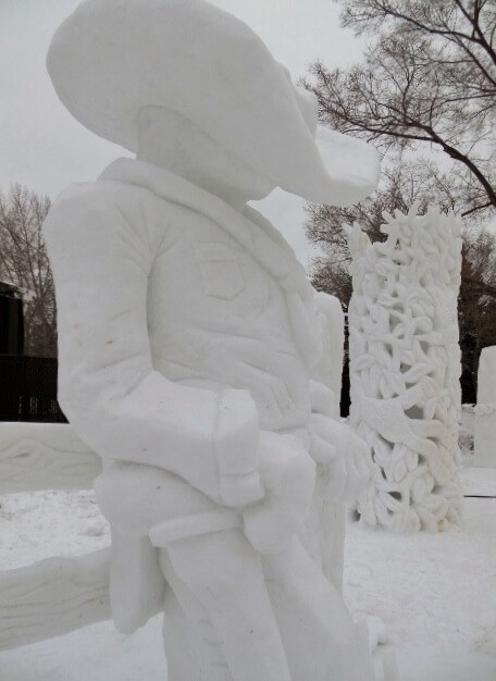Cowboy and lacy light snow sculptures at Silver Skate Festival Edmonton (photo by Sheila Scarborough)
