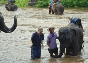Playing with--and washing!--the elephants in the river after the ride