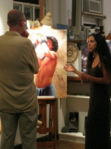 Dawn Traina, artist, and a customer in Hanapepe, Kauai (photo by Sheila Scarborough)
