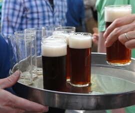 A tray of Altbier glasses on a tour of the house breweries in the old town of Dusseldorf in Germany