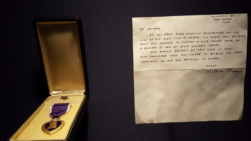 Family who lost a son in Korea sent his Purple Heart in protest at Truman Library Independence MO (photo by Sheila Scarborough)