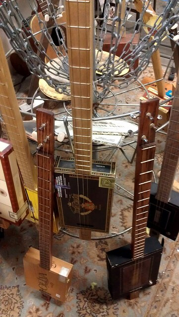 Clever use of a disc golf basket: instruments for sale at Nickel Cigar Box Guitars Huntsville AL (photo by Sheila Scarborough)