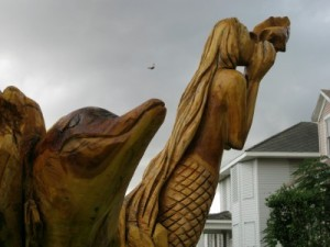 Galveston tree sculptures dolphins and mermaid closeup (photo by Sheila Scarborough)