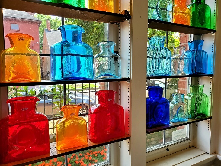 Glass bottle display at Helen Winnemore's German Village Columbus OH (photo by Sheila Scarborough)