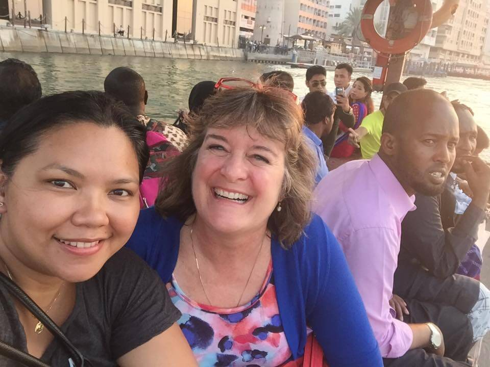 Dubai on a budget - Grace from Sandier Pastures and Sheila take a wooden abra boat across Dubai Creek (photo by Grace Gomez-Fujimaki)