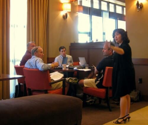 Hyatt Place General Manager checks on her breakfast guests (photo by Sheila Scarborough)