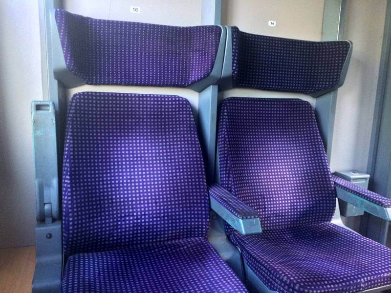 Some of the nicer train seats on a Romanian train.