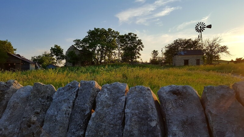 Kansas farm scene at sunset on the Native Stone Scenic Byway (photo by Sheila Scarborough)