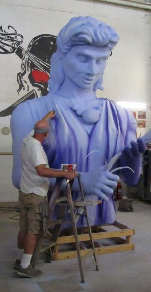 Man painting a model at Mardi Gras World in New Orleans