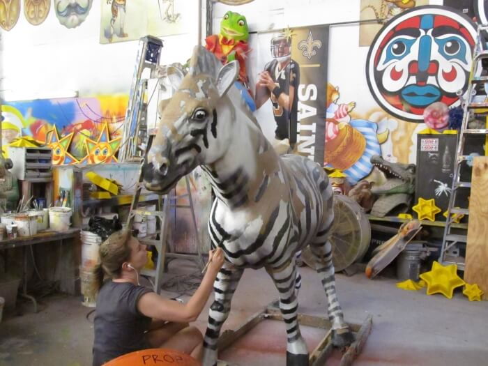 Painting a zebra at Mardi Gras World in New Orleans