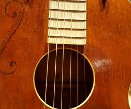 May Bell 1930s guitar owned by Woody Guthrie at the Guthrie Center in Tulsa OK (photo by Sheila Scarborough)