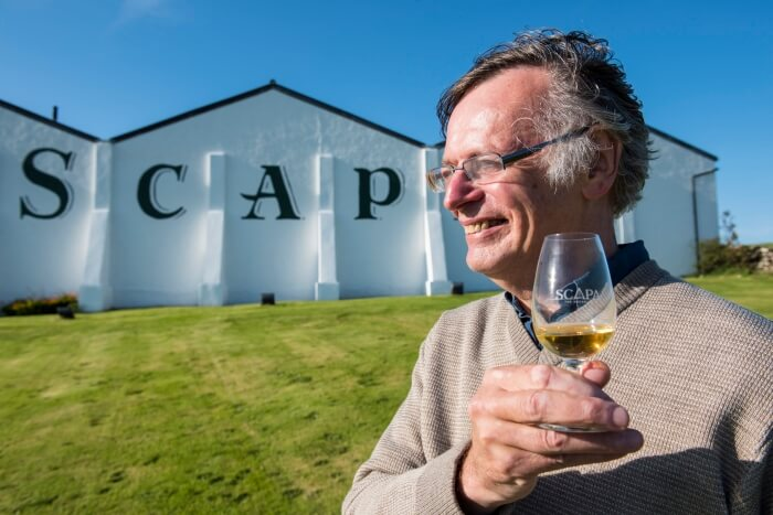 Author Mike Gerrard with a glass of Scapa whisky at the Scapa Distillery on Orkney in Scotland