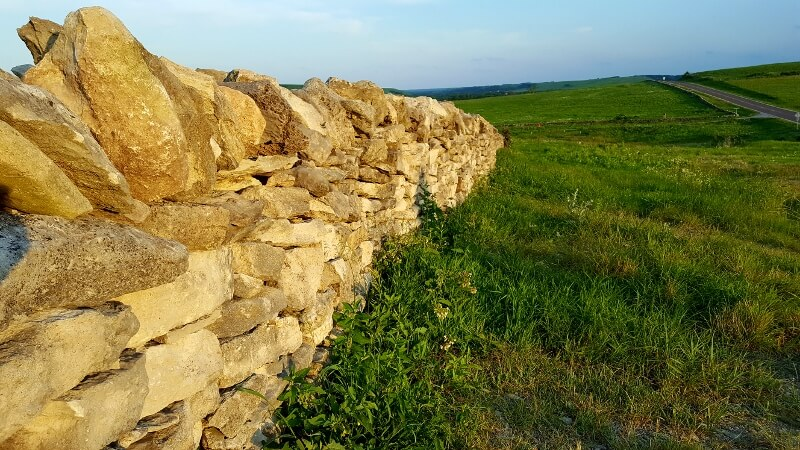 Native Stone Scenic Byway Kansas stone wall plus highway in distance photo by Sheila Scarborough)