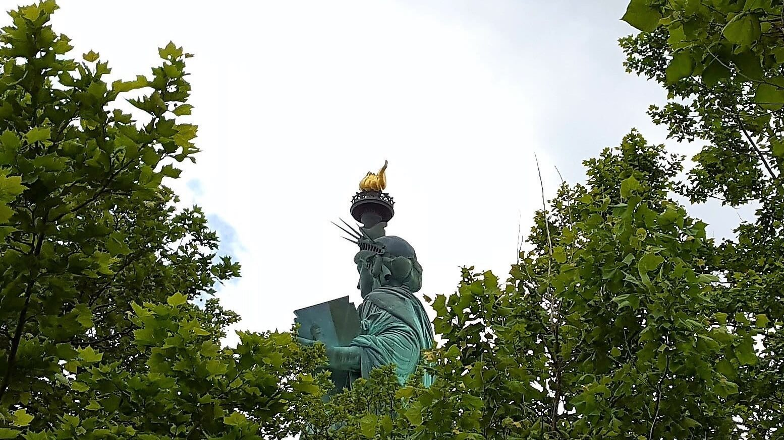New York's Lady Liberty through the trees (photo by Sheila Scarborough)