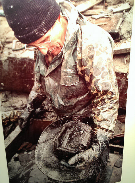 Excavating and preserving one hat at a time from Steamboat Arabia cargo; a photo at the museum of one of the original diggers