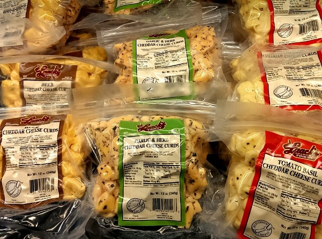 Eat local in a Main Street Town: part of the cheese curd selection at Mars Cheese Castle in Kenosha WI (photo by Sheila Scarborough)