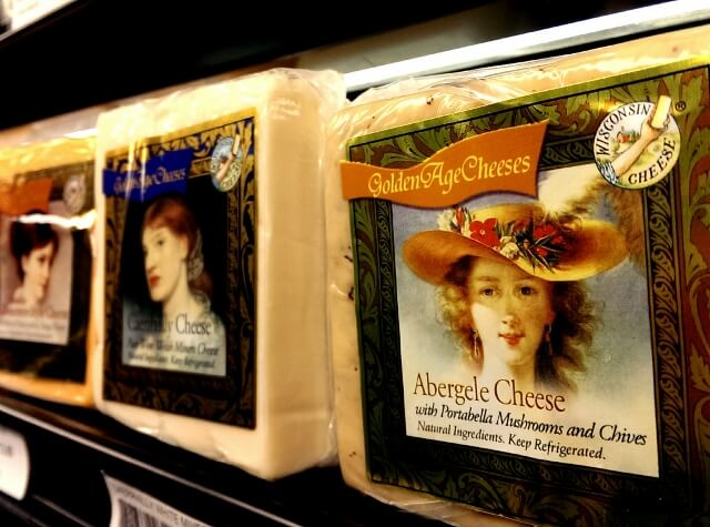 Local food in a Main Street town: pretty ladies adorn Harmony Specialty Dairy Foods Golden Age Cheeses - Wisconsin cheese at Mars Cheese Castle in Kenosha WI (photo by Sheila Scarborough)