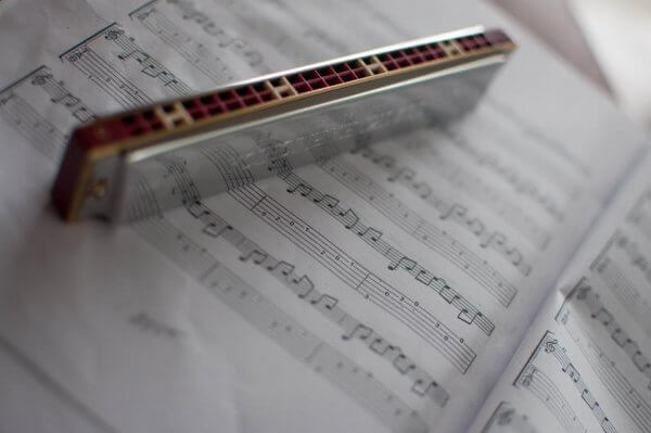 music score with harmonica by AJ Montpetit