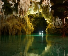 Rio Secreto Mexico cave cenote swimmers approach (photo courtesy Rio Secreto)