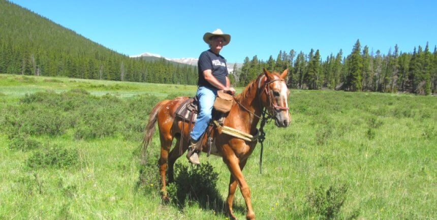 Mike Gerrard has his cowboy moment while horse-riding at Tumbling River Ranch in Colorado