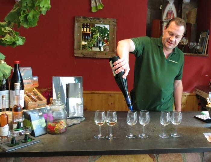 On a Rudesheim Wine Time wine tasting tour in Germany, Ralf Nagler pouring wine