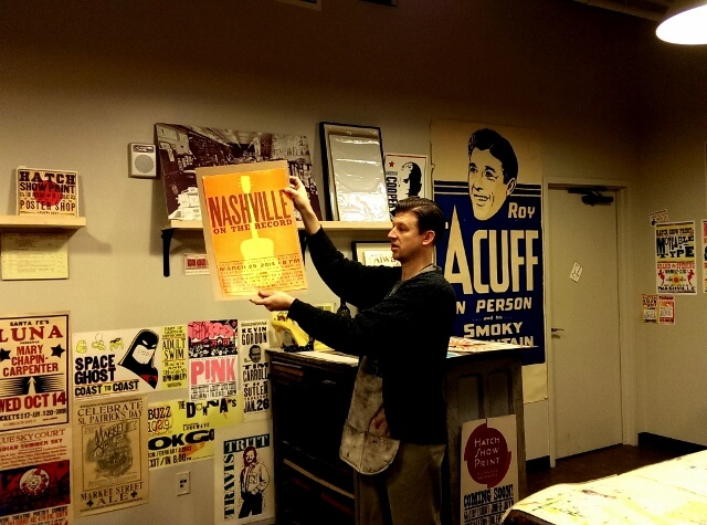 Showing the history of posters at Hatch Show Print Nashville (photo by Sheila Scarborough)
