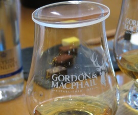 Whisky glass and chocolate truffles at the Gordon & MacPhail grocery and whisky shop in Elgin on Speyside in Scotland, at the Spirit of Speyside Whisky Festival.
