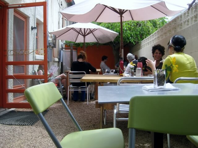 Squeeze Marfa's outdoor courtyard seating area fits more people than you'd think (photo by Sheila Scarborough)