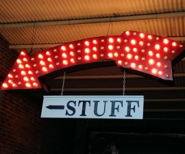 Shop local when you travel - lighted Stuff sign at Coker Tire Company Museum Chattanooga TN (photo by Sheila Scarborough)