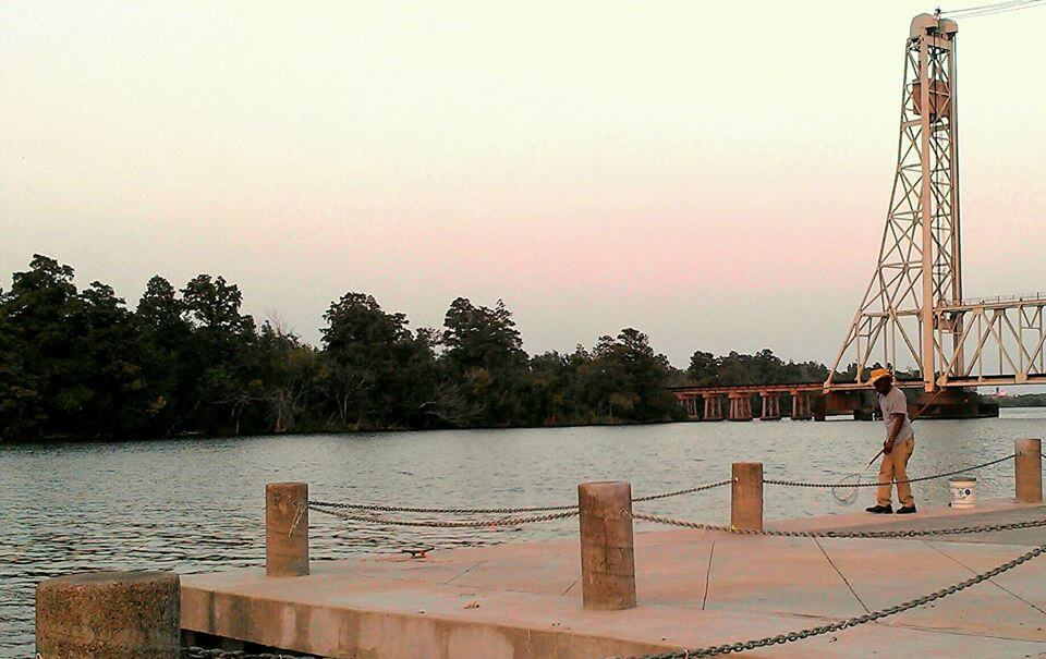 Sunset on the Neches River in downtown Beaumont TX (photo by Sheila Scarborough)
