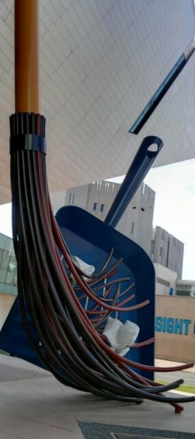 Sweeping up outside the Denver Art Museum (photo by Sheila Scarborough)