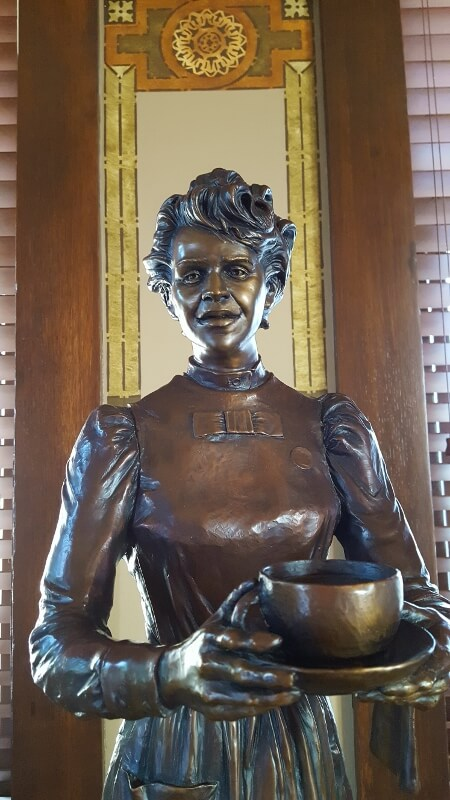 The Harvey Girl sculpture by Neil Logan at Brownwood TX Harvey House (photo by Sheila Scarborough)