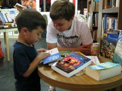 The boys at Talk Story bookstore, Hanapepe, Kauai (photo by Sheila Scarborough)