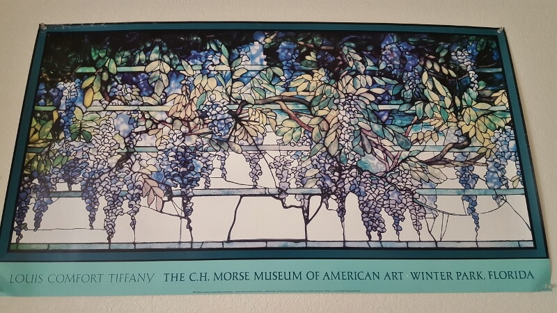 Poster from 1986 featuring the Morse Museum Tiffany stained glass windows in the Laurelton Hall dining room (photo by Sheila Scarborough)