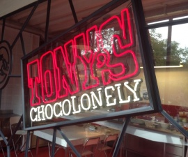 Sign in the window at Tony Chocolonely chocolate makers in Amsterdam, The Netherlands